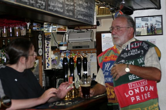 Chairman Malcolm in his coat of many bar towels.